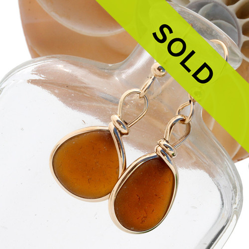 Vivid amber brown sea glass pieces set in our Original Wire Bezel© setting in gold with beach found sea glass from Puerto Rico to make a beautiful pair of genuine sea glass earrings.