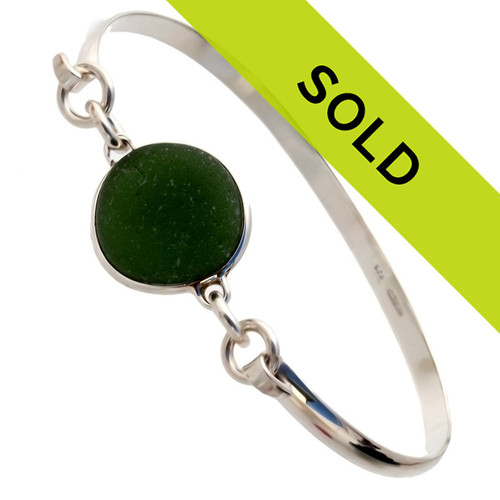A sea glass bracelet using dark green Seaham Sea Glass and set in sterling silver. Sorry this piece has been SOLD!