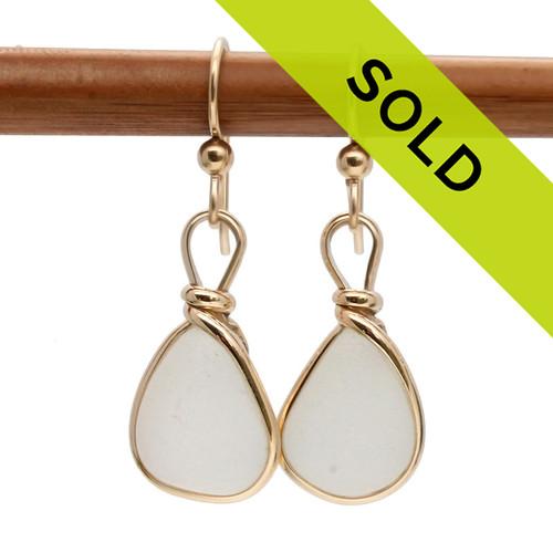 Sea Glass Earrings in white beach found sea glass. Set in 14K goldfilled bezel.