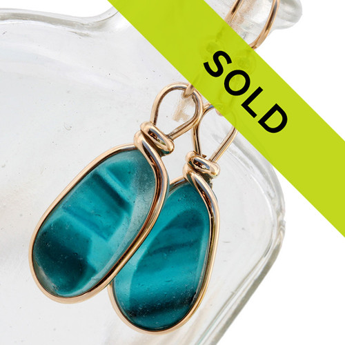 An ultra rare matched pair of multi colored sea glass from England these sea glass earrings set in gold are some of the rarest pairs in the world!