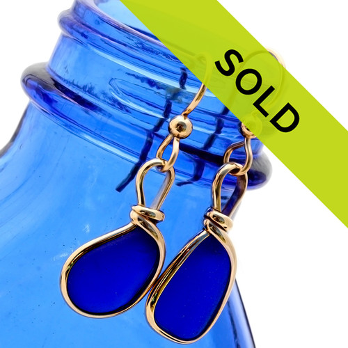 Petite cobalt blue sea glass pieces set in our Original Wire Bezel© earring setting in 14K goldfilled sea glass earrings.  These sea glass pieces are UNALTERED from the way they were found on the beach. TOP QUALITY GENUINE SEA GLASS!