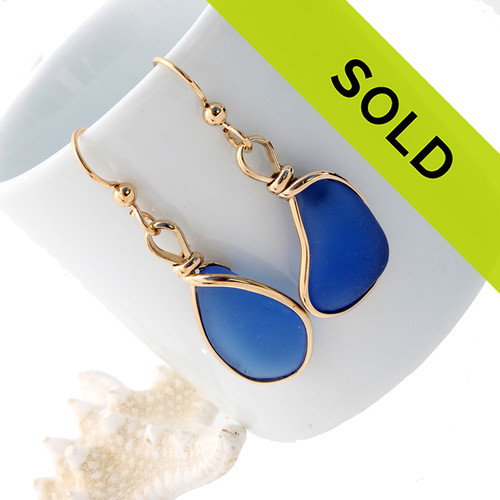 A beautiful pair of natural vivid medium blue beach found sea glass pieces set in our Original Wire Bezel© setting that leaves the sea glass TOTALLY UNALTERED from the way it was found. Sorry this sea glass jewelry selection has been sold!