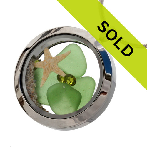 Perfect green sea glass combined with a real starfish brightened up with a ton of crystal  Peridot gems.  Peridot is the gemstone for August Birthdays! Sorry this locket has sold!
