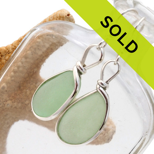 Sorry these sea glass earrings have been sold! This pair of seafoam green sea glass earrings is set in our signature and original Wire Bezel© setting.