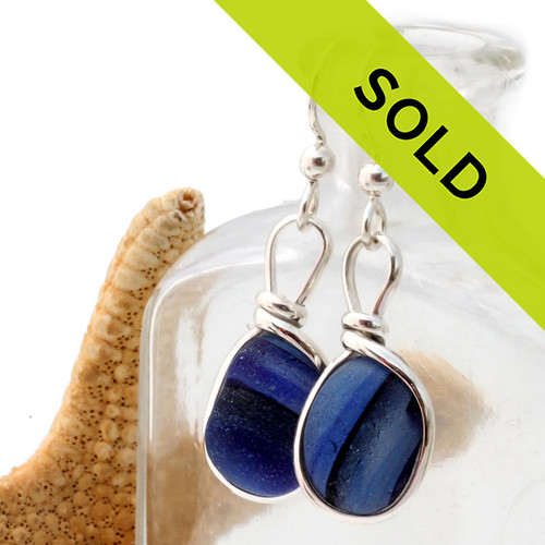 Unusual and hard to match cross sectioned multi End Of Day sea glass from England set in our Original Wire Bezel© sea glass earring setting. This is a VERY HARD sea glass to match and is a once in a lifetime pair! Sorry this one of a kind pair of sea glass earrings has been sold!