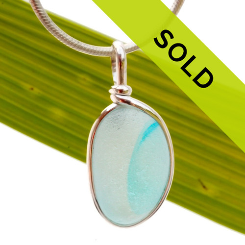 Our Original Wire Bezel© sea glass pendant setting lets all the beauty of this piece shine. A sterling silver bezel encases the sea glass and does NOT ALTER it from the way it was found on the beach in the UK.