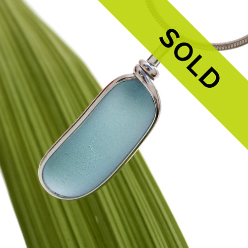 A beautiful very frosty long piece of Carolina Blue sea glass set in our Original Wire Bezel© setting. A great sea glass pendant for any necklace. Sorry this one of a kind pendant has been sold!