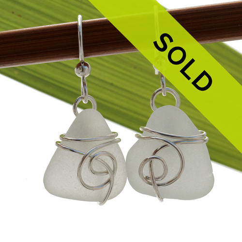 Perfect pair of pure white sea glass pieces in a sea inspired design.