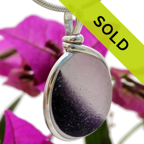 An amazing purple in a clear white base. An amazing vivid royal purple color set in our Original Wire Bezel© setting.