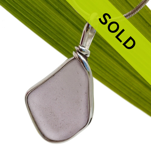 A top quality piece of lavender sun glass set in our Original Wire Bezel© sea glass pendant setting.