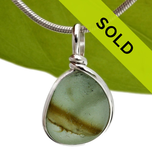 Stunning mixed moss green English sea glass from Seaham England set in our Original Wire Bezel Setting. Sorry this sea glass jewelry item has sold!