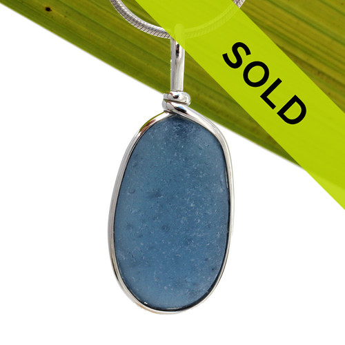 A large TOP QUALITY LARGE blue gray sea glass set in our Original Wire Bezel© necklace pendant setting that encases the glass in silver and leaves both front and back open so you can feel the texture of this antique top quality glass.