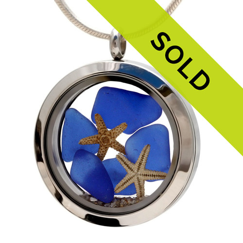 Blue beach found sea glass and a small REAL starfish in this one of a kind sea glass locket necklace.