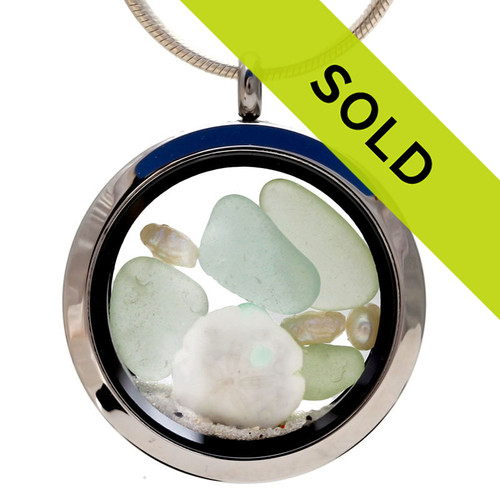 Seafoam Green sea glass combined with a real sandollar, fresh water pearls and beach sand  Great choice for a June Birthday! Sorry this sea glass locket has sold.