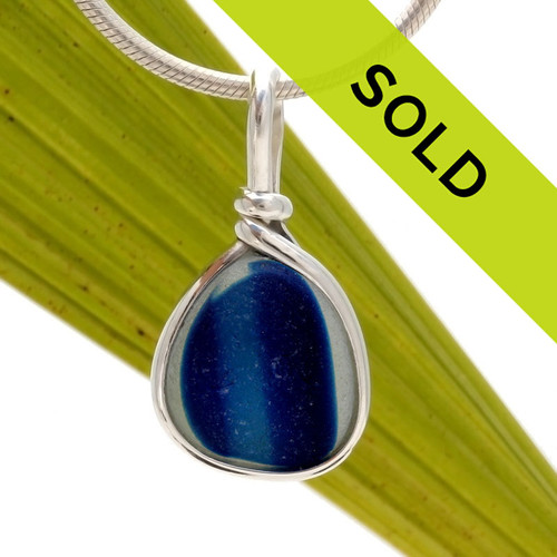 Intense mixed blue sea glass piece from Seaham England set in our classic elegant Original Wire Bezel Setting