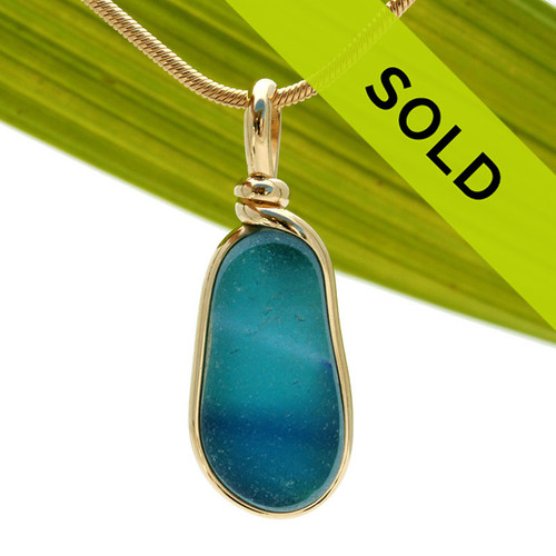 A stunning mixture of tropical aqua and blue in this one of a kind English art sea glass piece. It is set in 14K Rolled Gold in our Original Wire Bezel© setting. Guaranteed for a lifetime of enjoyment!