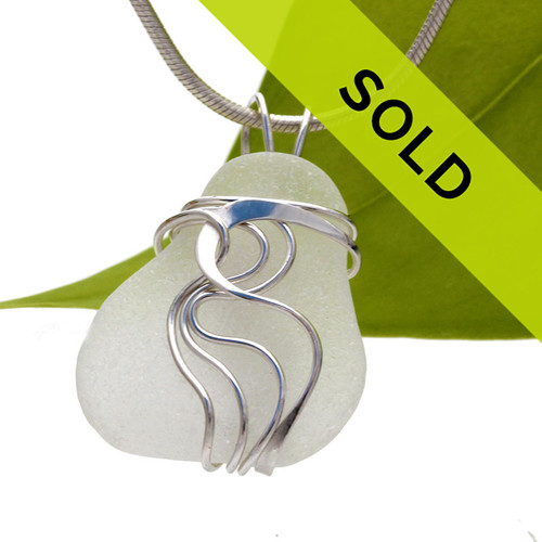 Top quality perfect white sea glass piece set in our sterling silver Waves© pendant setting. This is a LARGE piece and would look great on any necklace, sterling collar or Omega chain. Sorry this piece has sold!