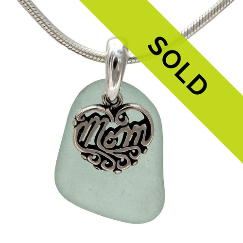 A beautiful piece of PERFECT vivid sea green sea glass on a cast sterling bail with a sterling MOM charm. An 18 inch solid sterling snake chain IS INCLUDED!