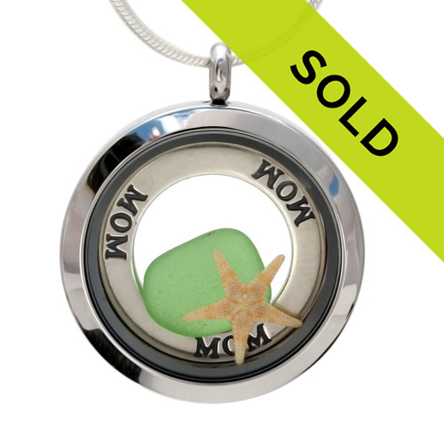 Real green beach found sea glass pieces combined are in this sea glass locket necklace. A solid sterling round MOM affirmation circle lets her know you are always on her mind, at the beach and always! Also looks like WOW - Mom upside down. A perfect mother's day gift!
