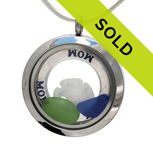 Real green & blue beach found sea glass pieces combined with a real sandollar in this sea glass locket necklace. A solid sterling round MOM affirmation circle lets her know you are always on her mind, at the beach and always! Also looks like WOW - Mom upside down. A perfect mother's day gift!
