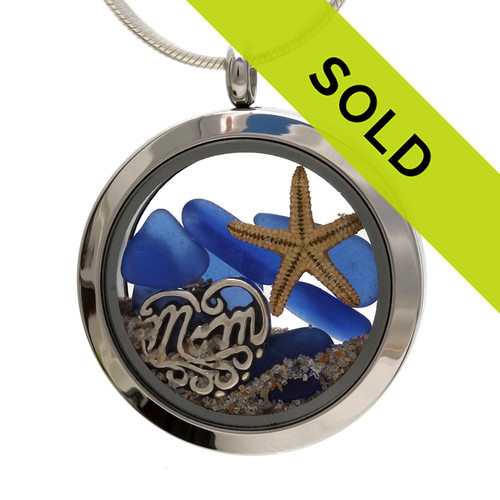 Genuine beach found blue sea glass combined with a real starfish and beach sand for a beachy mother's day gift.