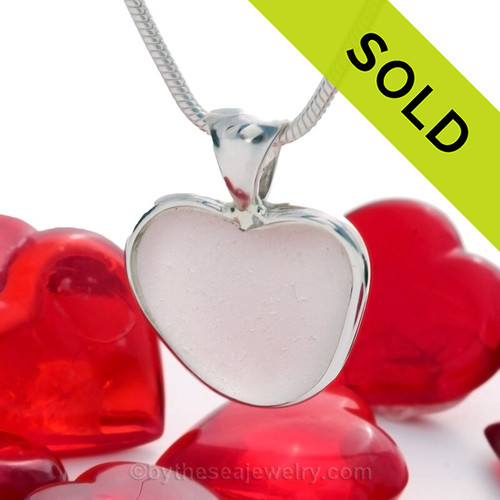 A beautiful pure white natural sea glass heart set in our deluxe wire bezel setting!