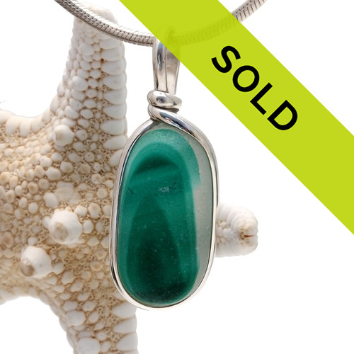 Stunning mixed green English sea glass from Seaham England set in our Original Wire Bezel Setting.