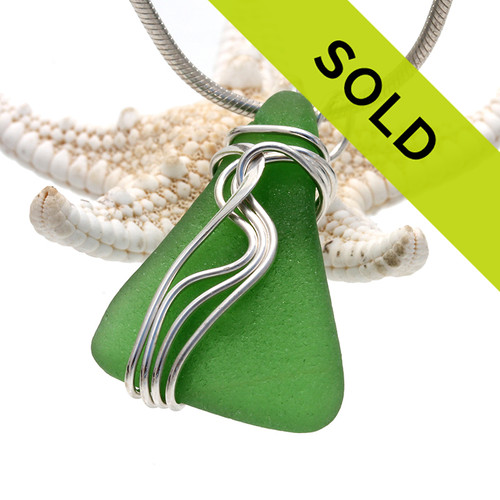 A nice natural piece of vivid green beach found sea glass in a my signature Waves© sterling necklace pendant setting.