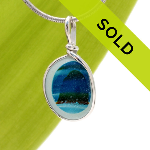 An Ultra Rare sea glass piece from Seaham England in our Original Wire Bezel© setting. The colors that were mixed totally by accident look like a mountain rising out of a tropical sea.