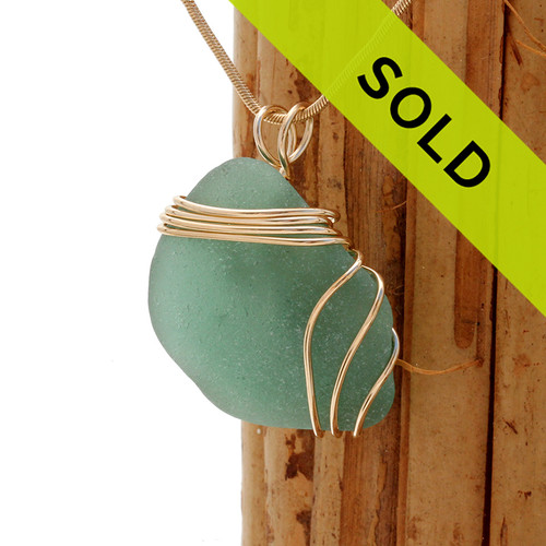 An unusual green sea glass piece set in our triple gold setting. A nice pendant for a summer necklace. Sorry this piece has sold!