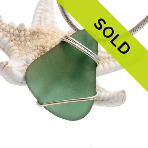 Seaweed green sea glass set in our basic beach sterling setting. A great simple pendant for any necklace!