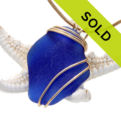 A LARGE curvy beautiful cobalt blue sea glass piece set in our tripled 14K Rolled Gold (goldfilled) setting. Sorry this piece has sold
