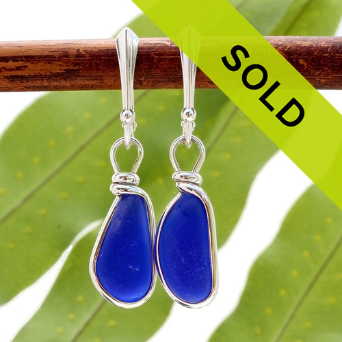 Vivid teardrop shaped cobalt blue sea glass pieces set in our Original Wire Bezel© setting. This pair comes on quality sterling silver lever back ear wires. Sorry this pair has sold!