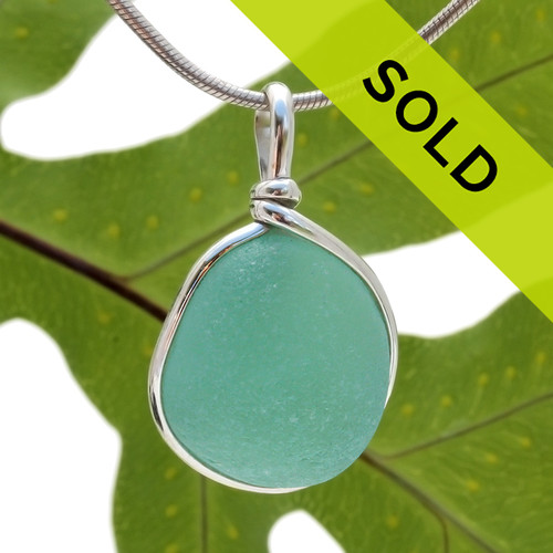 Great piece of natural sea glass in my Original Sterling Silver Wire Bezel© a simple design that lets all the beauty of this glass shine. Top quality sea glass.  Sorry this pendant has sold!