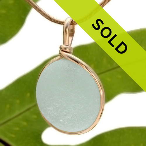 With just a hint of green, this pale seafoam sea glass pendant is set in our Original Wire Bezel© setting. This setting leaves the Victorian era sea glass TOTALLY unaltered from the way it was found on the beach!