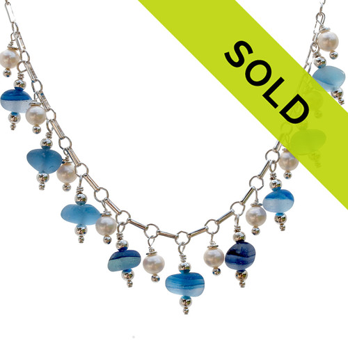 Ultra Rare Blue Multi English Sea Glass Necklace With Pearls on Sterling Necklace  This amazing and once in a lifetime sea glass necklace incorporates 9 rare English sea glass mutlies with AAA grade pearls on a solid sterling necklace.  A amazing once in a lifetime piece!