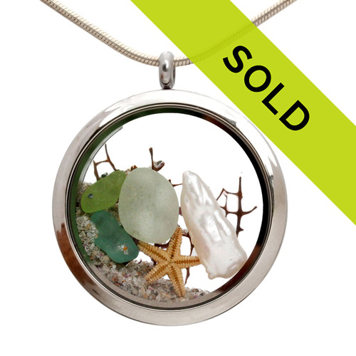 Genuine aqua, seafoam and lime green sea glass combined with a genuine fresh water stick pearl, a tiny starfish and real beach sand in this JUMBO 35MM stainless steel locket. Pearl is the birthstone for June!