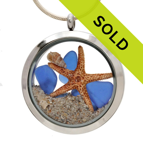 Genuine blue sea glass pieces combined with a real starfish, beach shells and real beach sand in this JUMBO 35MM stainless steel locket. Sorry this locket is no longer for sale.