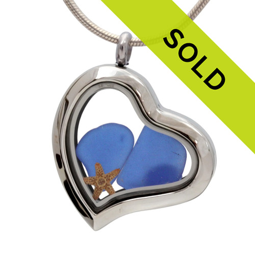 Our new heart lockets make this blue sea glass really shine! A tiny starfish completes the beachy look! Genuine beach found glass. SORRY THIS LOCKET HAS SOLD