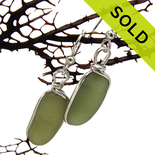 Our jewelry leaves our sea glass totally natural, just the way it was found on the beach. We use ONLY Genuine sea glass collected on beaches from around the world.  Sorry this Sea Glass Jewelry selection has been SOLD!