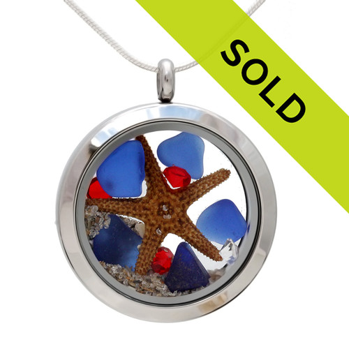Genuine blue beach found sea glass is combined with crystal ruby gemstones, a real starfish and beach sand in this silver stainless steel locket necklace. Sorry this sea glass jewelry piece has been sold!