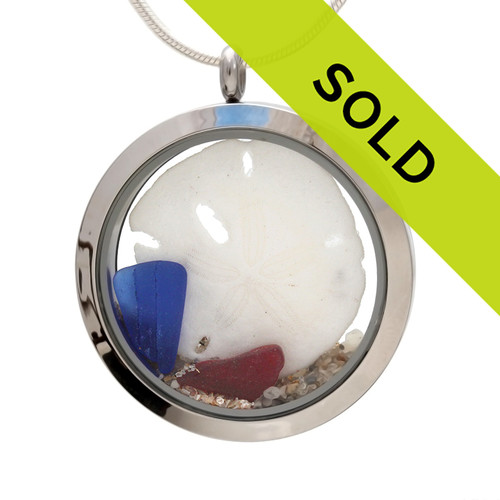Genuine blue and ruby red sea glass pieces combined with large sandollar real beach sand in this JUMBO 35MM stainless steel locket necklace. Sorry this piece has sold!