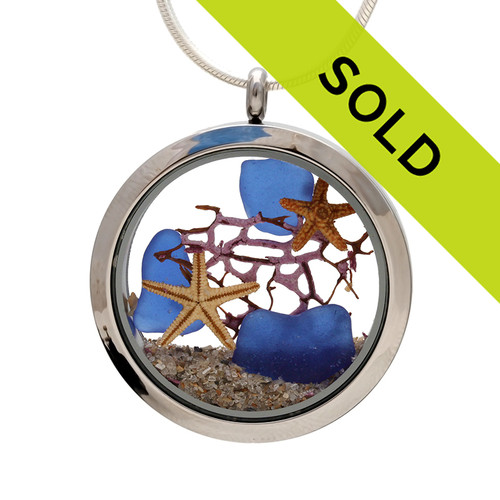 Genuine blue sea glass combined with a piece of vintage sea fan a tiny starfish and real beach sand in this JUMBO 35MM stainless steel locket.  Great underwater scene!