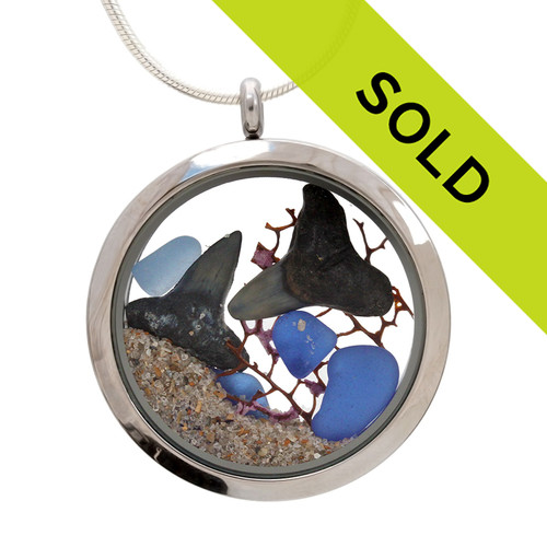 Genuine blue sea glass combined with a piece of vintage sea fan,two real fossilized sharks teeth and beach sand  in this JUMBO 35MM stainless steel locket.  Great underwater scene!