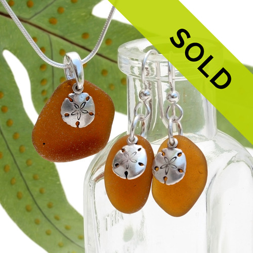 Warm amber brown sea glass is combined with solid sterling sandollar charms for an awesome sea glass set in silver. Sorry this sea glass set has been sold!