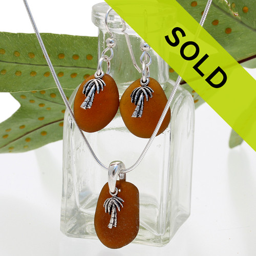 Warm amber brown sea glass in a silver set of earring and matching pendant with silver palm trees. Sorry this sea glass jewelry item has been sold!