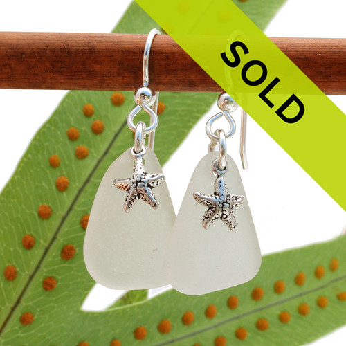 White goes with everything and you will find yourself wearing these sea glass earrings all year long.