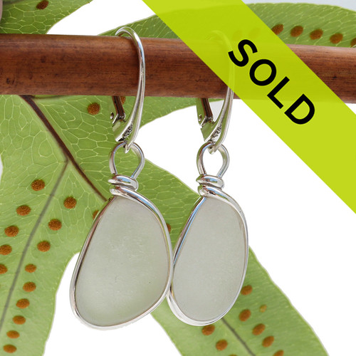 Perfect petite pieces of white beach found sea glass set in a lovely pair of genuine sea glass earrings in sterling. Our Original Wire Bezel© lets all the beauty of the sea glass shine without altering the glass in any way! This pair comes on top quality sterling leverbacks (shown).