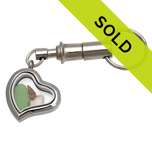 Green beach found sea glass and a small shells in this detachable heart shaped chain. SOLD