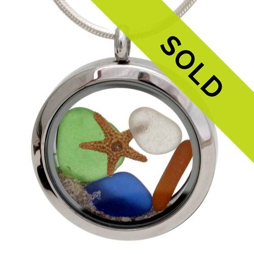 Blue, green amber and pure white sea glass combined with a real baby starfish and topped off with natural beach sand in this sea glass locket necklace. Sorry this locket has sold!